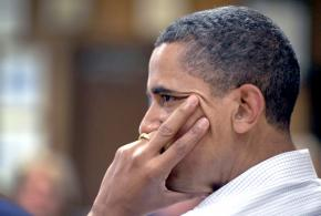 President Obama listens to a report on the impact of the BP oil spill on the Gulf Coast