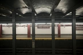Weekend service cuts leave a New York City subway station empty