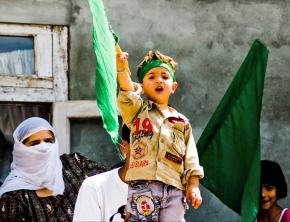 A little boy takes part in mass protests against the Indian occupation of Kashmir
