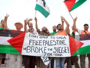 Members of the latest Viva Palestina convoy celebrate after going through the Rafah crossing into Gaza