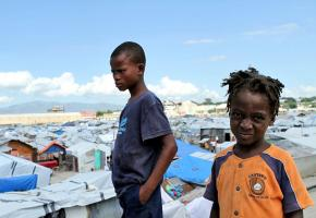 Two young Haitians still stuck at the La Piste refugee camp in Port-au-Prince