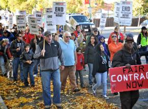 Locked-out Castlewood workers and their supporters march through the streets of Pleasanton, Calif.