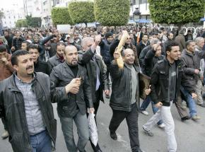 Tunisians march in Tunis for bread and an end to the reign of a dictator