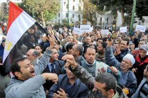 Protesters gather outside the parliament building in Cairo on Tuesday