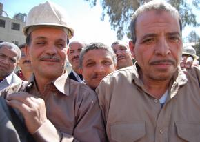 Workers at the Tora Cement factory celebrate after a successful sit-in over pay and conditions in 2009