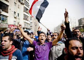Protesters wind through the Nasr City neighborhood of Cairo