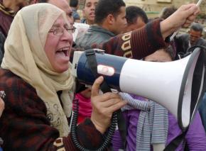 A woman leads chants against Hosni Mubarak in Tahrir Square