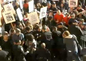 Police attack a crowd of protesters outside the UC Regents meeting in November 2010