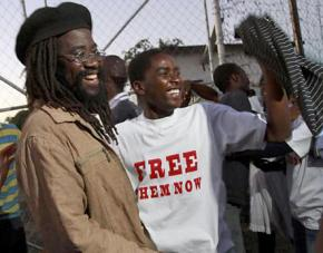Munyaradzi Gwisai and fellow activists celebrate as they are released from prison