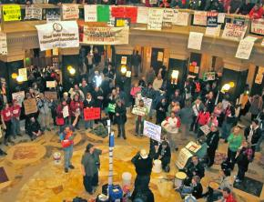 A crowd gathers in the Wisconsin Capitol rotunda to hear speakers talk on the people's mic