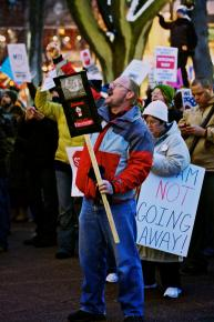 Crowds of people gathered in furious protest as lawmakers rammed through Scott Walker's union-busting assault