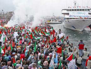 Supporters cheer as the Mavi Marmara returns from the first Gaza Freedom Flotilla