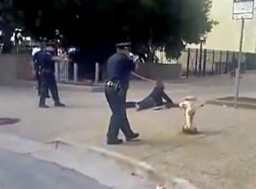 San Francisco police train their guns on Kenneth Harding as he bleeds to death