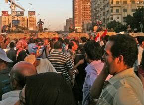 A mass march from Tahrir Square is blocked by military vehicles and soldiers