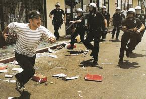 Police chase a a young man during 1992 riots in Los Angeles