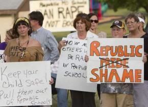 Parents and community members protest the failure of the Republic School District to keep a young rape victim safe