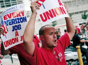 Verizon workers rally in the midst of their strike against concessions