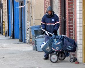 A mail carrier working a cold day in New York City
