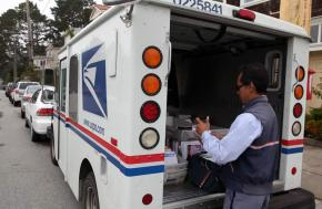 Some 120,000 postal workers could face layoffs if Congress approves pending legislation