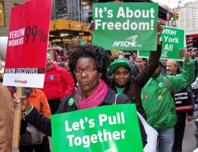 Occupy Wall Street supporters march in solidarity with Verizon workers
