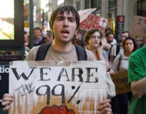 Occupy Wall Street supporters march through lower Manhattan