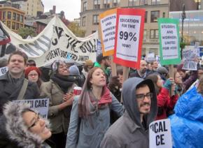 Students rallied at Union Square Park during the Occupy day of action before marching to Foley Square