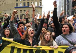 Occupy protesters march toward Liberty Plaza after police evicted them in the early morning hours
