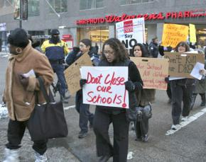 Teachers, parents and community activists march against Chicago public school closures