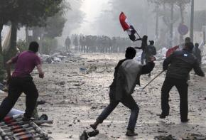 Protesters confront Egyptian military forces outside the Cabinet headquarters