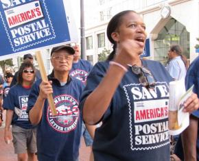Postal workers protest proposed cuts during a nationwide day of action
