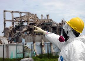 An IAEA inspector surveys damage at the Fukushima plant's Reactor Unit 3