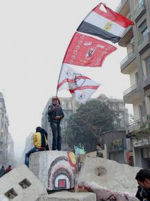 A Zamalek ultra joins in street battles in Cairo during protests about the Port Said massacre