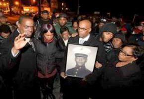 Family members and supporters protest the murder of Kenneth Chamberlain Sr.