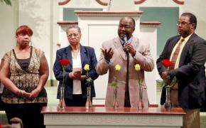 Community members mourn the victims of the racist shooting spree in Tulsa