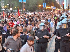 Protesters march through the streets of Chicago to demonstrate their opposition to NATO's crimes