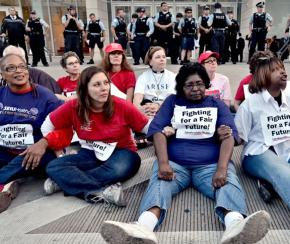SEIU members sit in with Chicago teachers at a protest last fall