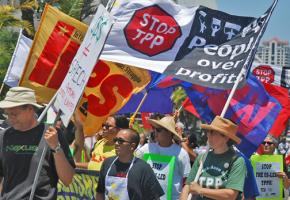 Activists in San Diego march against the Trans Pacific Partnership trade deal