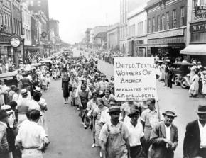 Textile workers on strike parade through Gastonia, N.C.