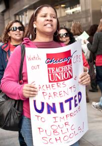 Teachers and parents picket outside a Chicago Board of Education meeting