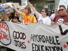 Occupy protesters march outside the first day of the Republican National Convention