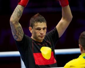 Boxer Damien Hooper wearing a T-shirt bearing the Aboriginal flag
