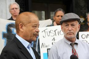 Attorneys Walter Riley (left) and Dan Siegel join activists at a press conference demanding justice for Alan Blueford