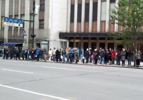 The line for the Second Avenue bus stretches half a block as transit service is restarted