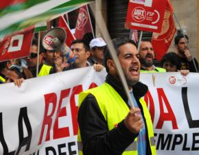 Spanish workers march during the recent multinational strike in Europe