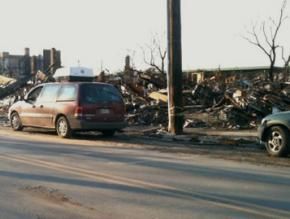 An entire block of stores and apartments in Rockaway Beach burned down during the storm