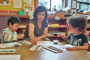 A Portland preschool teacher with her students