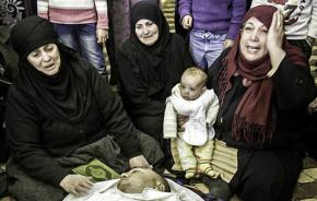 A family living near Homs mourns a loved one killed in the bombing
