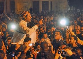 Anti-Morsi protesters massed outside the presidential palace in Cairo