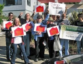 Larry Faulks (second from right) and anti-eviction activists rally outside his home