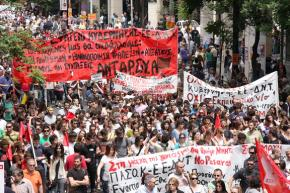 Greek workers march in Athens during a general strike against austerity measures